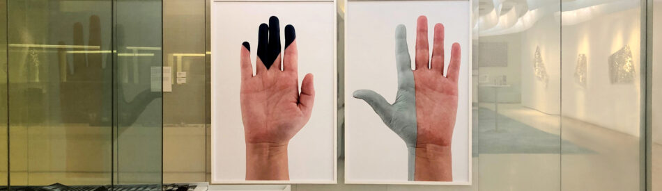 Rachel Beach, from left to right: Caron (navy hand) and Up Tack (grey blue hand). Both photographs: 2017, archival photographic print, wood frame, 72 x 48 inches, Edition of 5, 2 AP. Courtesy of the artist. Photo: Erica Kyung